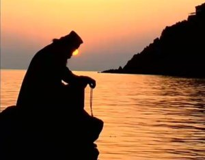 monk praying sunset